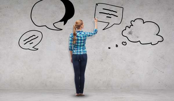 happiness and people concept - smiling young woman writing or drawing text bubbles on virtual screen